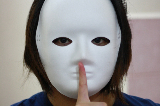 Person behind mask