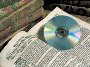 800px-Old_book_and_DVD