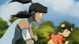 Korra uses the Avatar State to win a race against a small child.