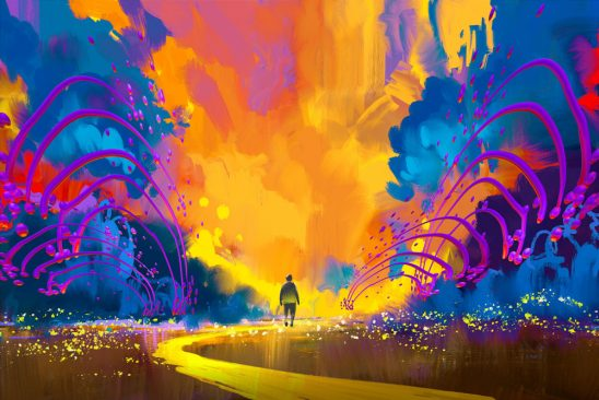 A person walks down a path into a place with bright and colorful clouds