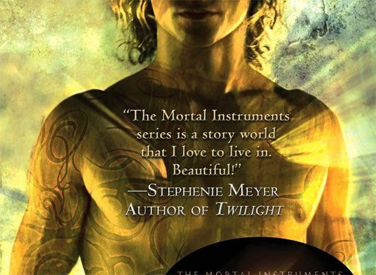 A bare-chested young what man with strange patterns on his skin on the cover of City of Bones