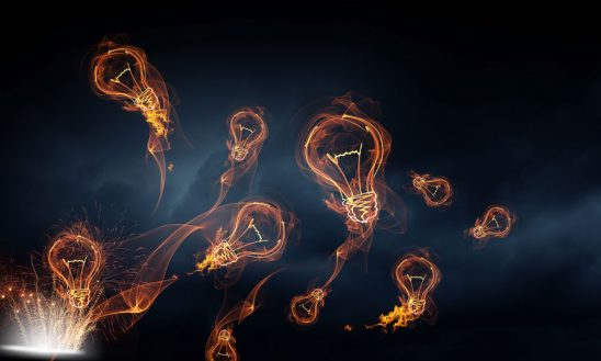 flying light bulbs on a black smokey background