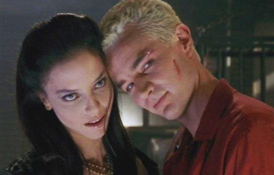 Spike and Drusilla with heads together