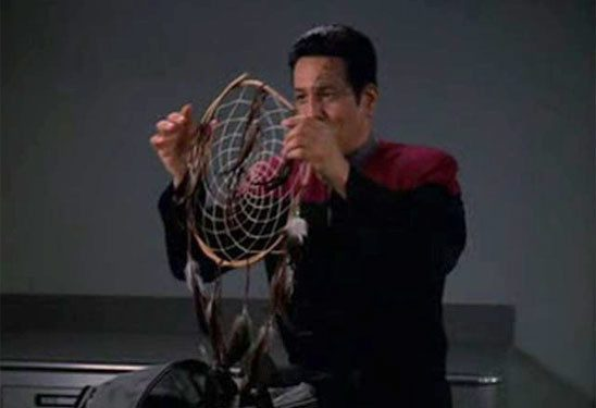Chakotay holding dream catcher