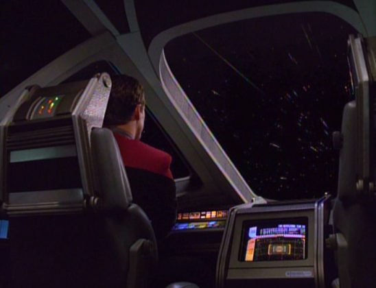 Tom Paris in a shuttle, about to hit warp ten.