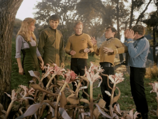 Kirk and crew getting sprayed by alien flowers.