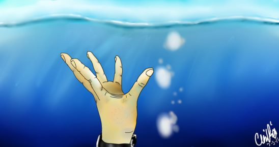 A hand reaching for the water's surface.