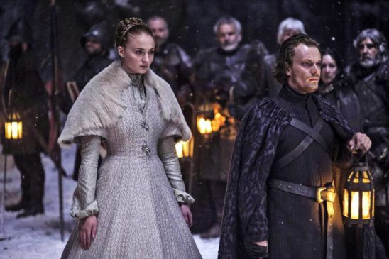 Sansa in her wedding gown, led by Theon