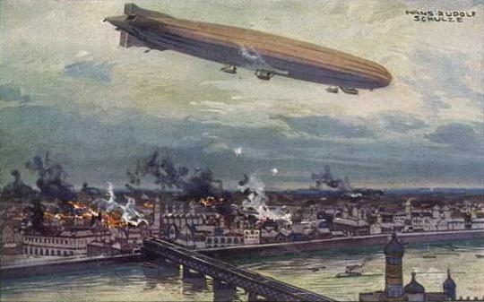 A zeppelin bombing a city in WWI.