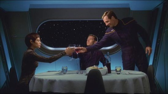 Archer, Tucker, and T'Pol sharing a toast.
