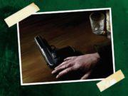 Pistol and empty shot glass. Standard Delta Green Loadout.