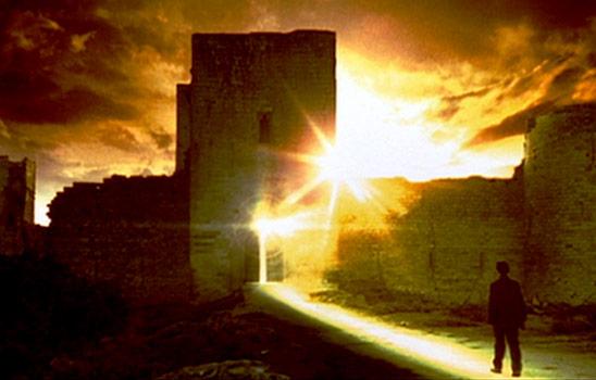Man walks toward glowing open doors of castle