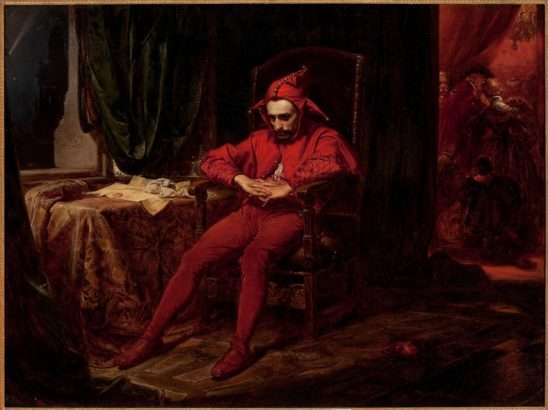 A red clothed jester in a fancy chair.