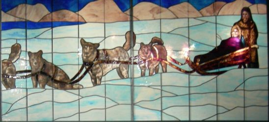 A stained glass painting of a dogsled.