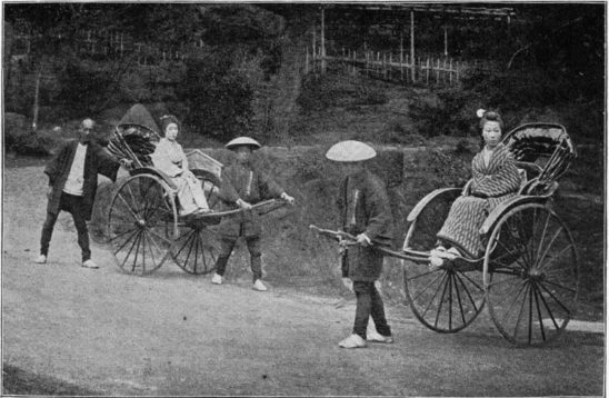 A historical photo of Japanese rickshaws.