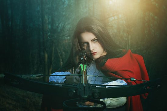 Red Riding Hood aims a crossbow