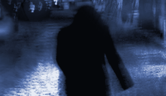 Cover art from Chronicles of Darkness, showing a shadow on an empty street.