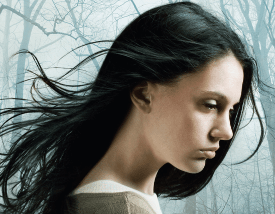 A woman with dark hair in profile, taken from the cover art of The Forest of Hands and Teeth
