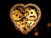 A steampunk pendent, heart shaped with gears inside.