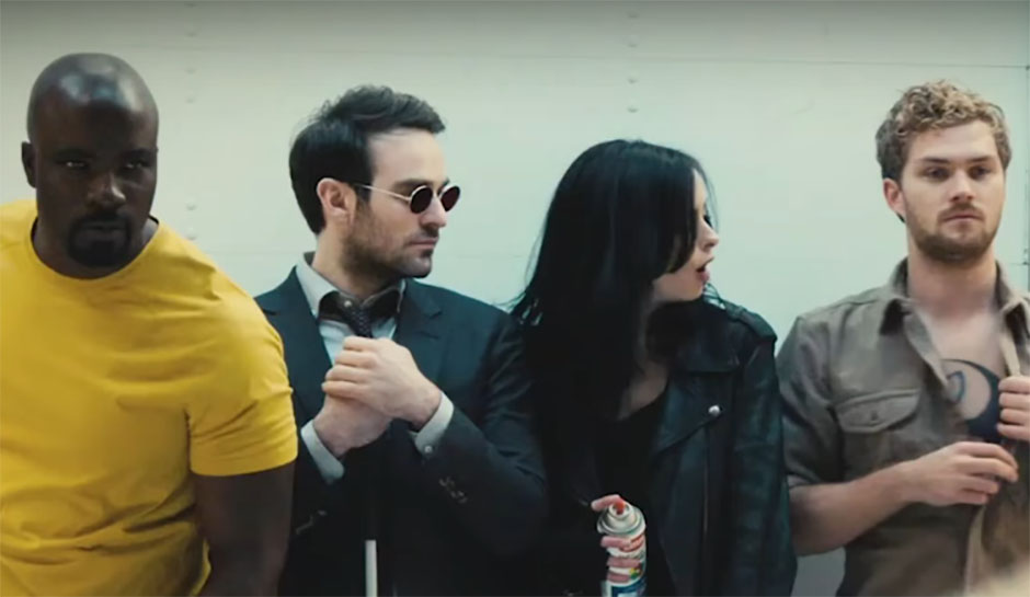 The actors for Netflix's Defenders, with Jessica Jones looking at Iron fist like he just said something rude.
