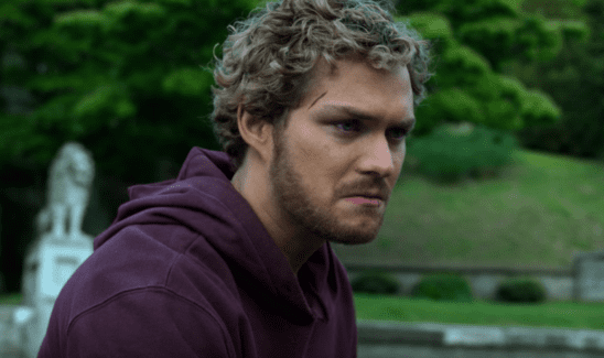 Danny Rand from Iron Fist, sulking with a purple sweater.