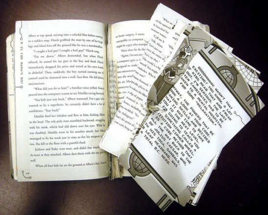 A book with pages torn out.