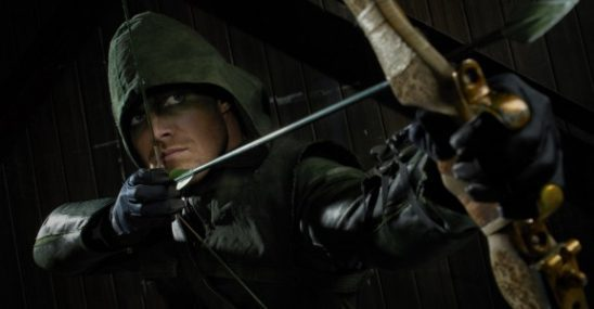 Green Arrow pulling back his bow.