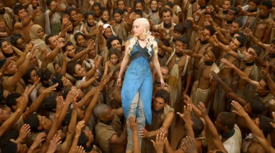 Daenerys being held aloft by freed slaves.