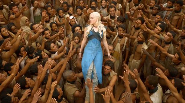 Daenerys being held aloft by freed slaves.