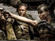 Furiosa and Max aiming guns.