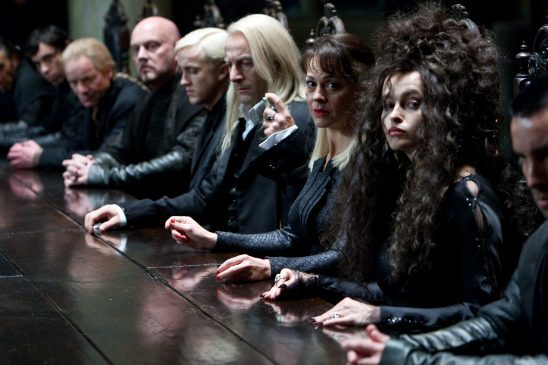 A bunch of death eaters at a table.