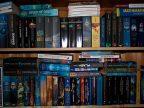 A book shelf full of speculative fiction titles.