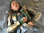 Loki on the ground after being beaten up by the Hulk.