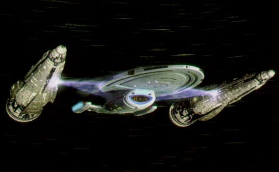Two ships toeing Voyager with tractor beams.