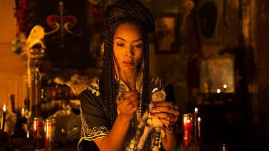 Marie Laveau from American Horror Story, working on a voodoo doll.
