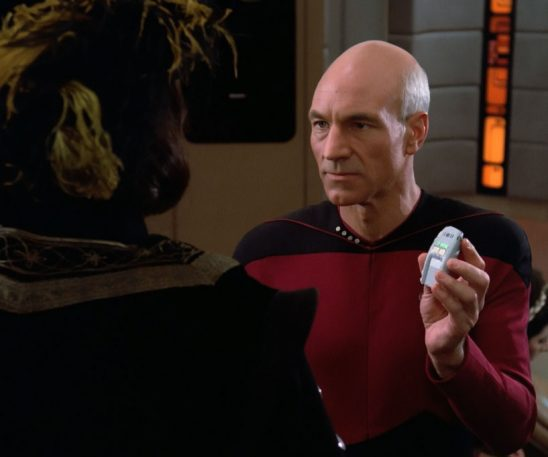 Picard holding a type one phaser.