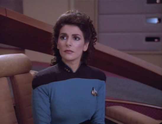 Troi looking pensive.
