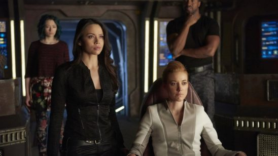 The Dark Matter characters on their bridge.