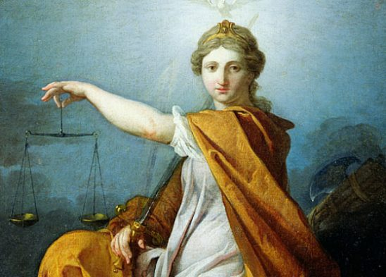 Lady Justice sits with her sword, holding up her scales