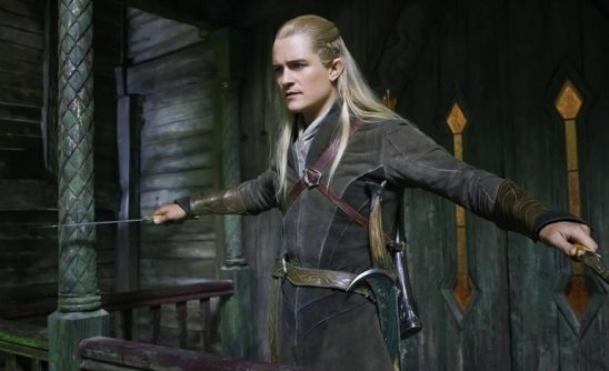Legolas wielding two swords.