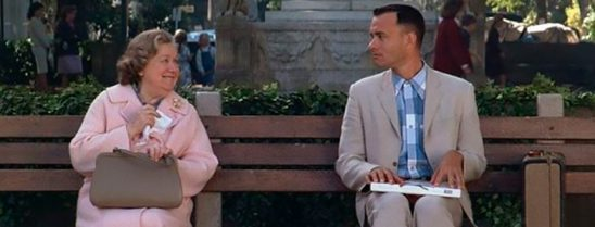 Forrest Gump on a bench with his box of chocolates.