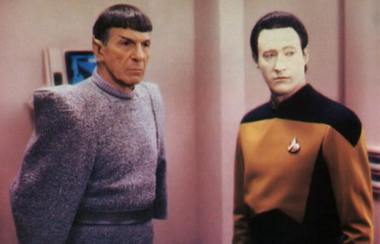 Spock and Data from Star Trek stand next to each other