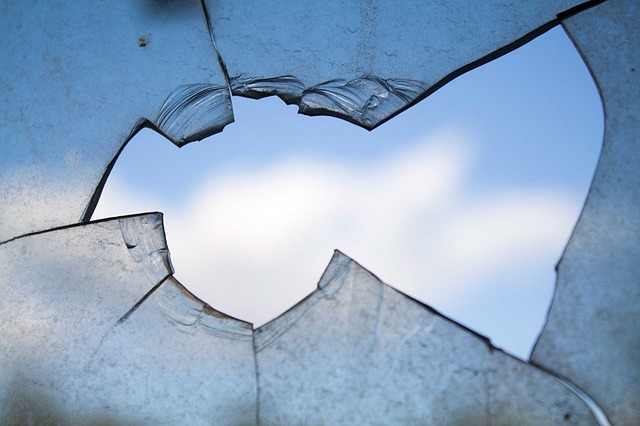 Broken window with a blue sky on the other side