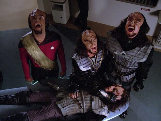 Worf and two other klingons performing the deal howl.
