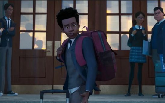Miles Morales stand on the steps of his new prep school, looking unhappy