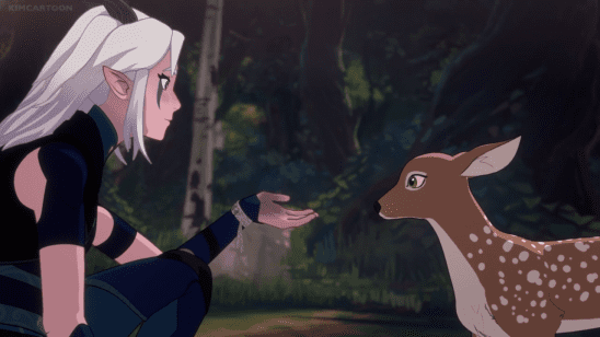 Rayla putting her hand out to a baby deer in Dragon Prince.