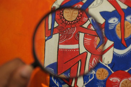 A magnifying glass focuses on a character in a painting