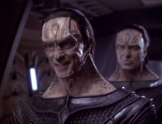 Dukat standing in front of Damar on Deep Space Nine.