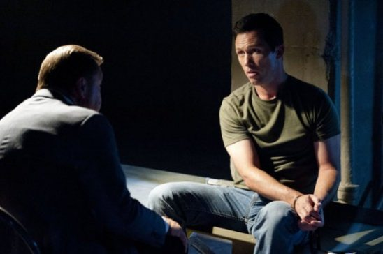 Michael having a conversation with someone in Burn Notice.