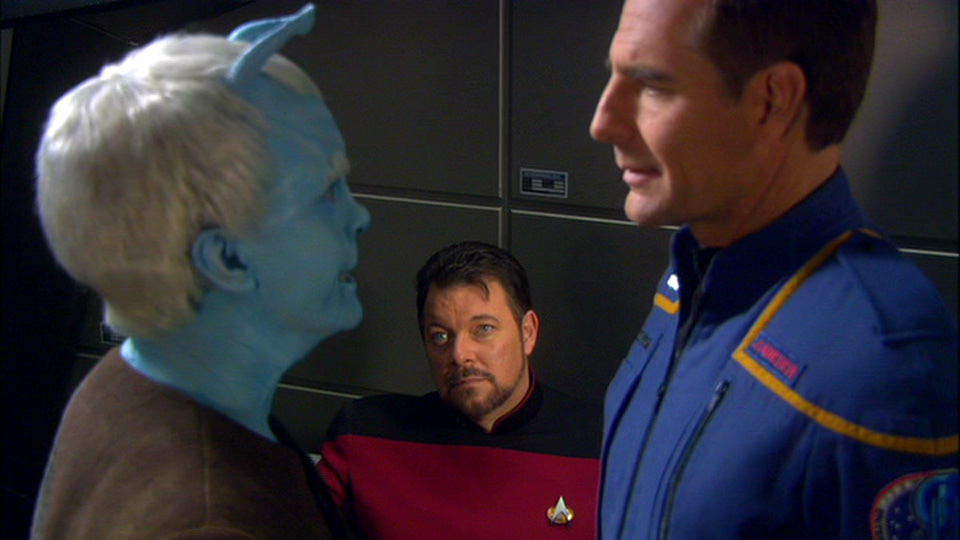 Riker watching holograms of Shran and Archer argue.